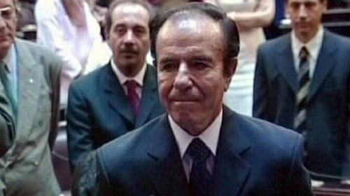 "Carlos Menem, seen here in 2005 as he was sworn in as a senator, says he is ""completely innocent"""