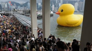 Thousands say farewell to a giant rubber duck conceived by Dutch artist Florentijn Hofman, before it heads to the United States