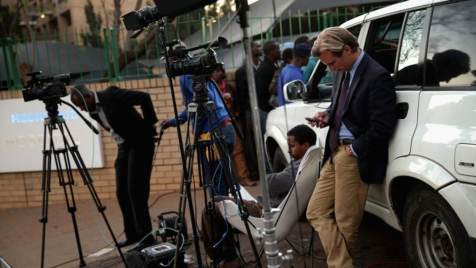 Members of the media wait outside the hospital in Pretoria, South Africa, where Nelson Mandela is being treated