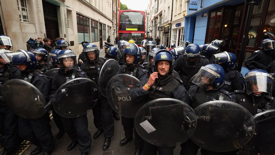 Riot police hold off protesters in London during a demonstration ahead of the G8 summit in Northern Ireland