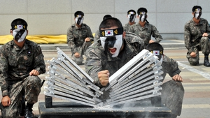 South Korean soldiers perform martial arts as part of preparations for the Asian Indoor and Martial Arts Games in Incheon