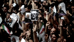 Iranian presidential candidates campaign for elections, as opposition leader Mir Hossein Mousavi remains under house arrest