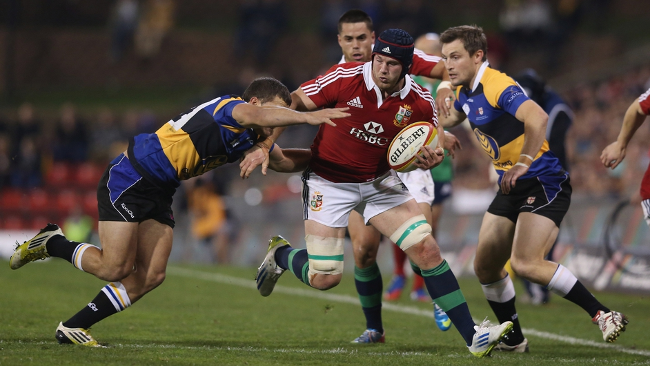 Sean O'Brien is tackled during the match between Combined Country and the British & Irish Lions in Newcastle, Australia