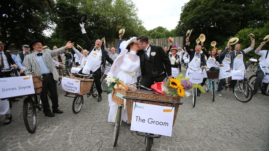 Bride and Groom Alfreda O'Brien and Ciaran Kavanagh taking part in the 20th Annual Bloomsday Messenger Bike Rally in Dublin ahead of their wedding