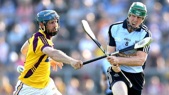 Garrett Sinnott of Wexford and Dublin's John McCaffrey clash in Wexford Park