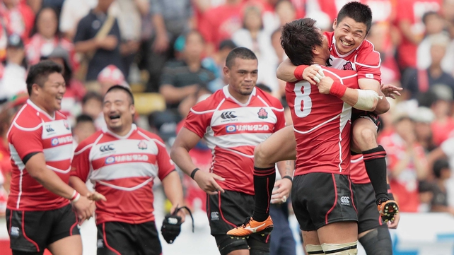 Japan celebrate their first ever win over Wales