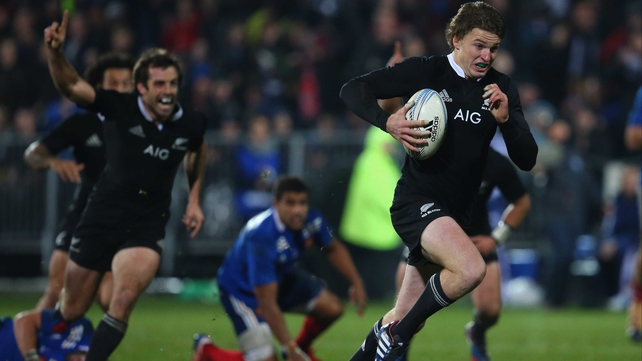 Beauden Barrett heads for the try line for New Zealand