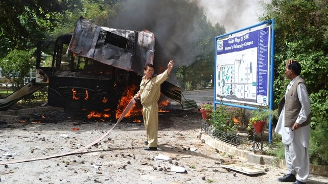 Firefighters extinguish flames in aftermath of explosion on a bus in Quetta, Pakistan