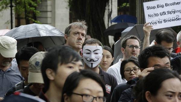Protesters gather in Charter Garden at the start of the protest rally to support Edward Snowden in Hong Kong