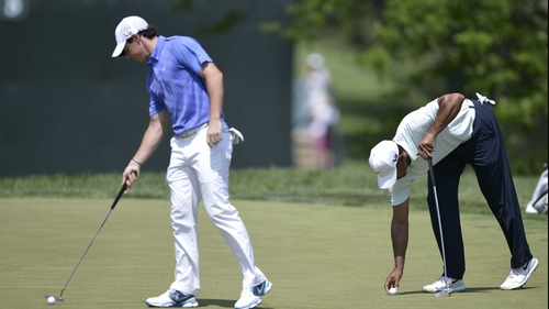 Rory McIlroy and Tiger Woods completing bogeys on the third