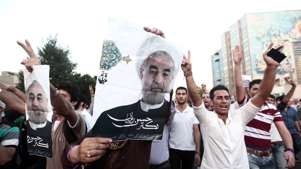 Hassan Rouhani's supporters have celebrated his victory on the streets of Tehran