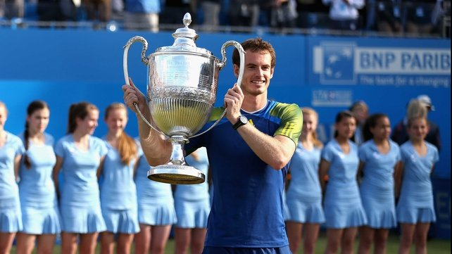 Andy Murray lifting the trophy he also won in 2009 and 2011