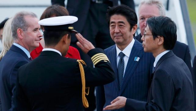 Japan's Prime Minister Shinzo Abe (2nd R) arrives