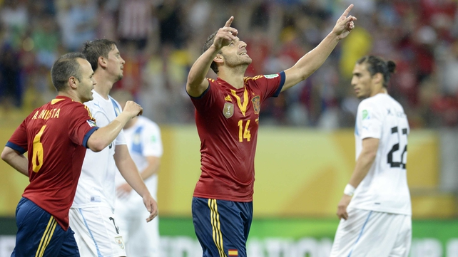 Roberto Soldado celebrates scoring La Roja's second goal in Recife