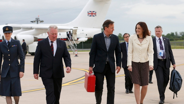 David Cameron walks with Northern Ireland Secretary Theresa Villiers (2nd R) on arrival