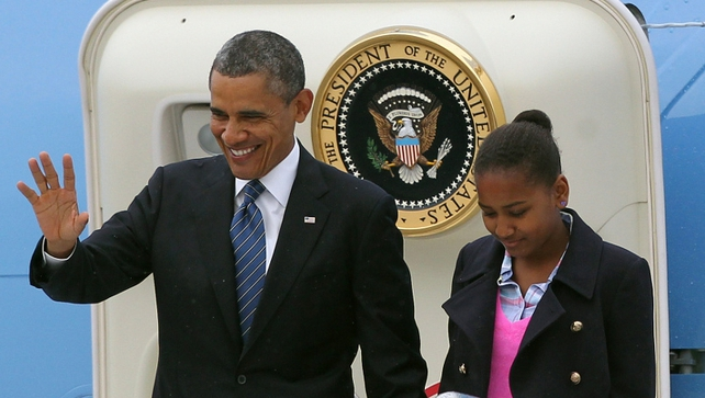 Barack and Sasha Obama alight from Air Force One in Belfast