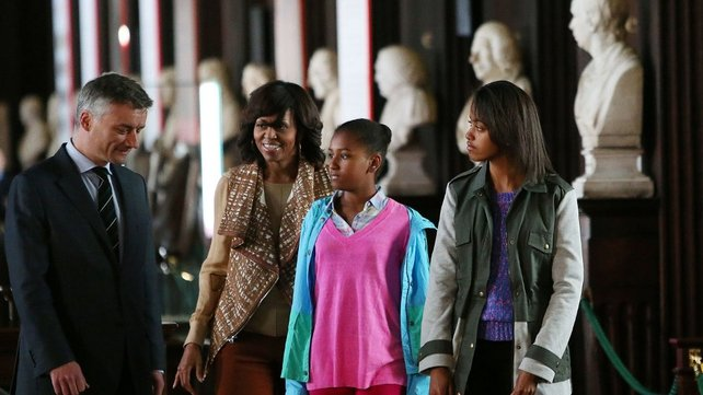 Michelle Obama and her daughters speak with Trinity Provost Dr Patrick Prendergast during their tour of the Long Hall Library