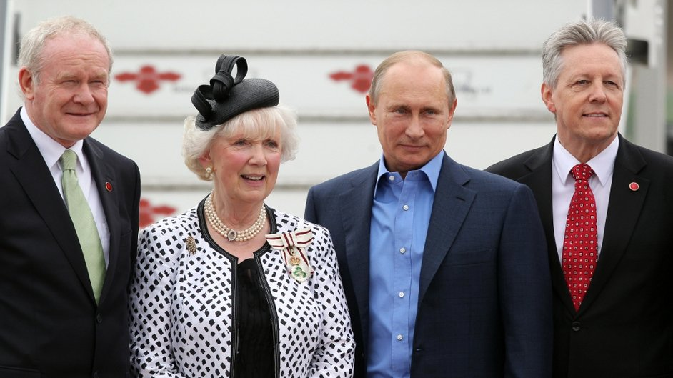 Russian President Vladimir Putin poses for a picture with Peter Robinson, Martin McGuinness (L) and Joan Christie, Queen Elizabeth's official representative in Co Antrim