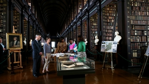 The First Lady was shown the Obama Family archives in the Long Hall Library