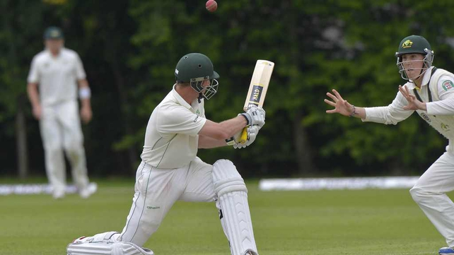 Andrew White (23) hits a tempting one to Australia's Nic Maddinson in Stormont