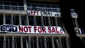 A 'not for sale' banner hangs on the facade of the Greek state television ERT headquarters