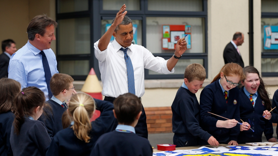 David Cameron and Barack Obama help students from Enniskillen Integrated Primary School work on a  G8 project