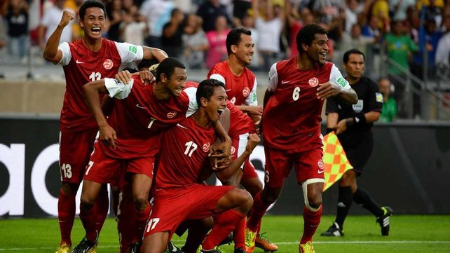 Tahiti celebrate their goal against Nigeria