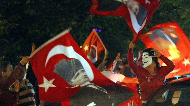 Anti-government protesters chanted slogans and waved flags during a demonstration in Ankara