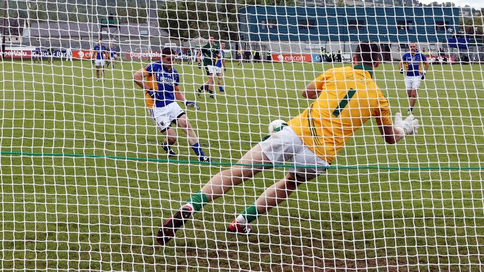 Meath goalkeeper Paddy O'Rourke saves Seanie Furlong's penalty during their game with Wicklow