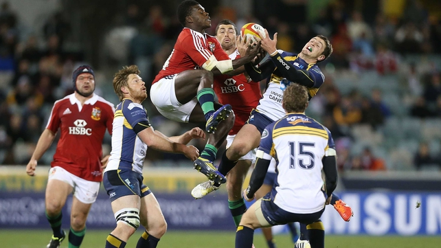 The Lions' Christian Wade and the Brumbies' Ian Prior vie for possession at Canberra Stadium