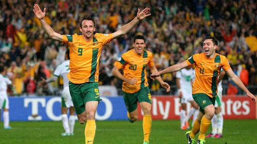 Josh Kennedy celebrates in front of jubilant Australian supporters