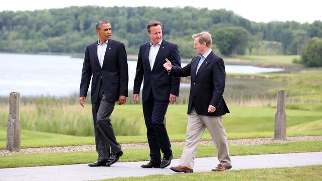 Barack Obama, David Cameron and Enda Kenny walk around Lough Erne
