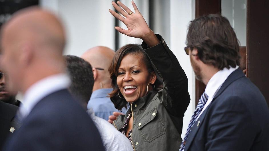 Mrs Obama waves to the crowds following lunch at Finnegan's pub