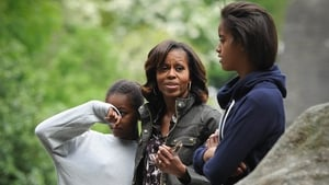 Sasha Obama battled with the midges, while her mother and sister listen to the tour guide