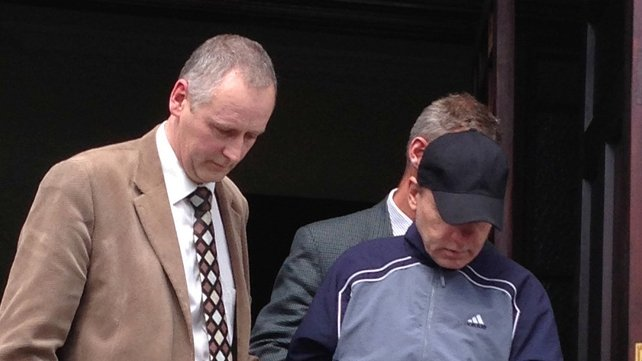 Dariusz Weckowicz (wearing baseball cap) was remanded in custody until 21 June