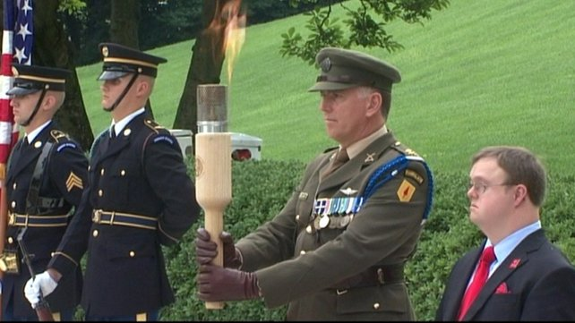The flame was handed over during a ceremony at Arlington National Cemetery