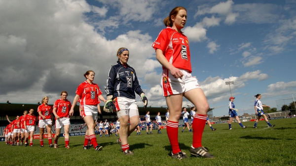 Rena Buckley leading the Cork footballers out last year