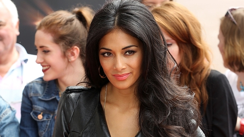Scherzinger vamped it up in a black leather dress