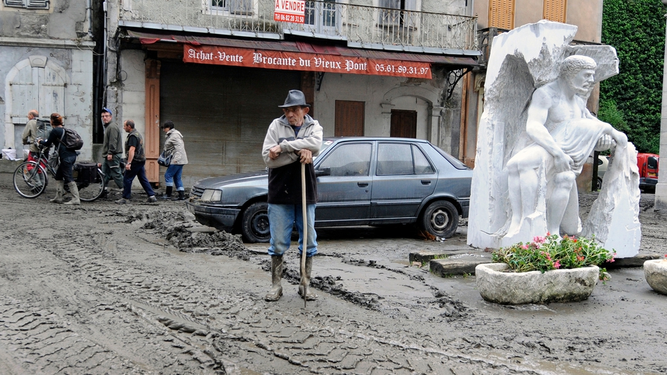 A villager takes a rest from the clean-up operation in Saint-Beat