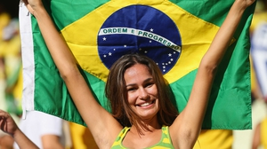 A Brazil fan cheers on her team to victory in the Confederations Cup