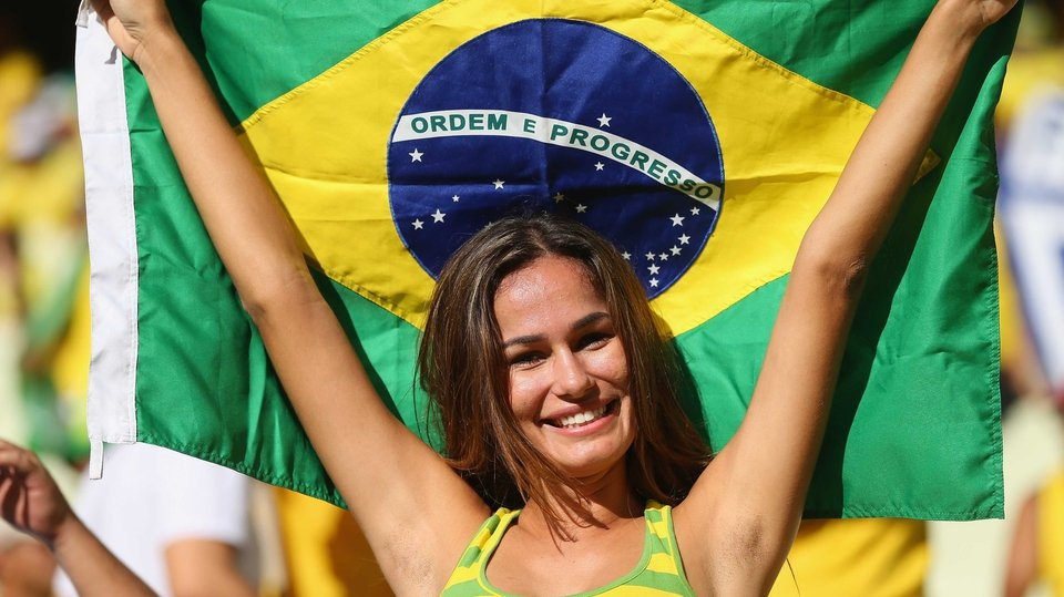 A Brazil fan cheers on her team at the Confederations Cup