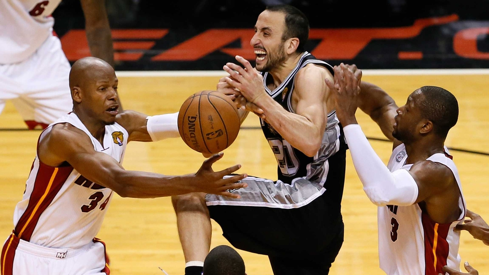 Manu Ginobili (c) of the San Antonio Spurs loses the ball as he drives between Ray Allen and Dwyane Wade of the Miami Heat