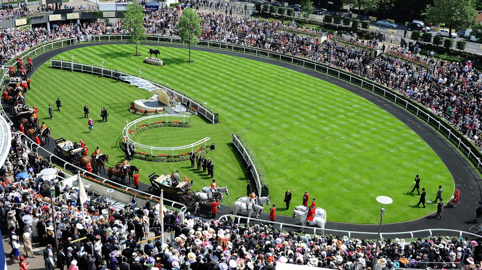 The Royal Carriage Procession makes it way around the Parade Ring during day two of Royal Ascot