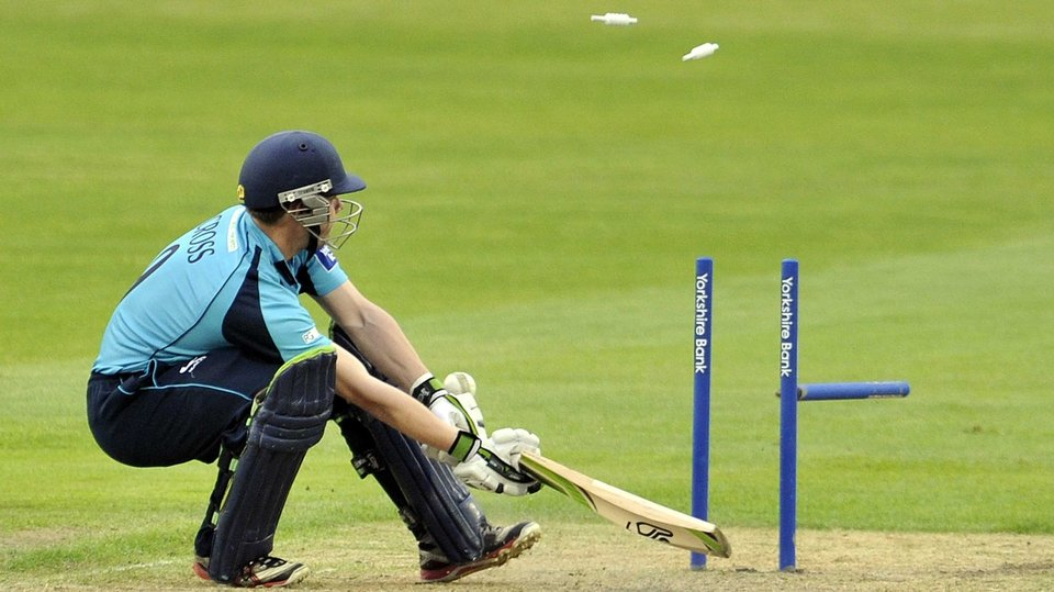 Matthew Cross is bowled out during the match between Lancashire Lightning and Scottish Saltires at Old Trafford