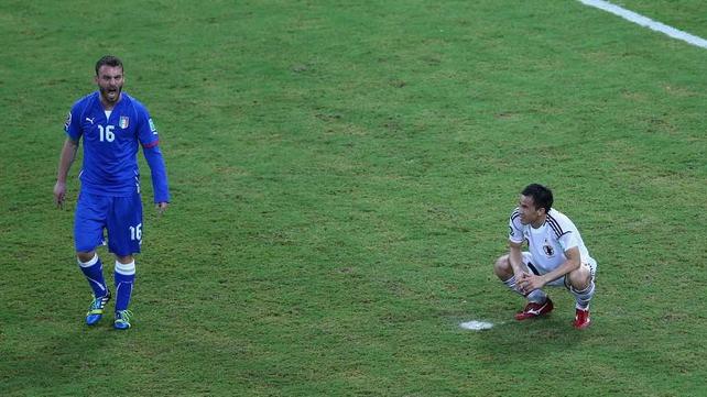 Shinji Okazaki of Japan looks dejected as Japan were beaten despite leading 2-0 at one stage