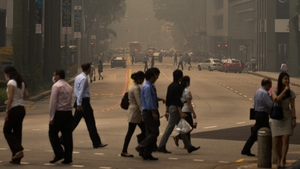 Some people are wearing masks to protect themselves from the haze
