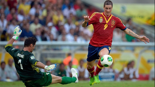Fernando Torres rounds Tahiti goalkeeper Mickael Roche
