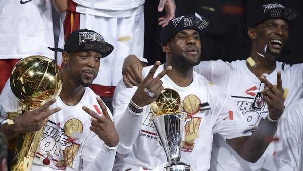Dwyane Wade (L), LeBron James (C) and Chris Bosh (R) of the Miami Heat