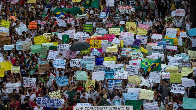 Thousands of people march in the centre of Recife