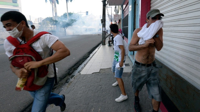 Protesters disperse after riot police fired tear gas in Salvador, Bahia